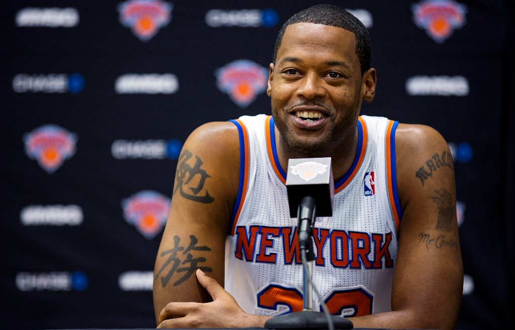 New York Knicks center Marcus Camby smiles as he answers a question during their NBA basketball media day at the team's training facility in Greenburgh, N.Y., Monday, Oct. 1, 2012. (AP Photo/Craig Ruttle)