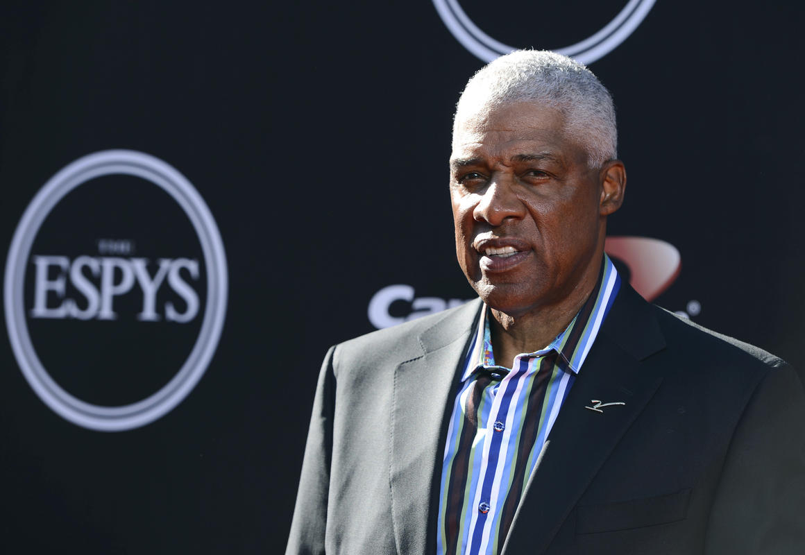 FILE - In this July 16, 2014 file photo, NBA legend Julius Erving arrives at the ESPY Awards at the Nokia Theatre in Los Angeles. Erving fell ill at the Philadelphia 76ers' game Friday, Jan. 5, 2018 and was taken to a hospital. There was no immediate update on his condition. (Photo by Jordan Strauss/Invision/AP, File)